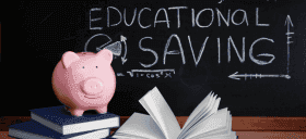 Educational savings written on a chalk board with a piggy bank.