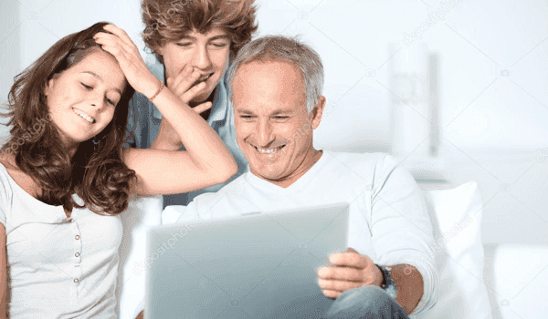 Family of three looking at computer