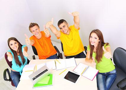 A group of students giving the thumbs up.