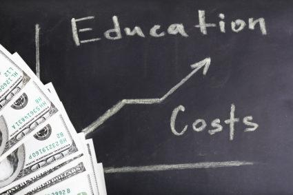 Education costs concept on a chalkboard.