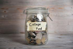 A jar full of money with college fund label.