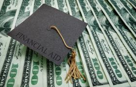Graduation cap on 100 dollar bills.