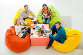 A group of college students on bean bags.
