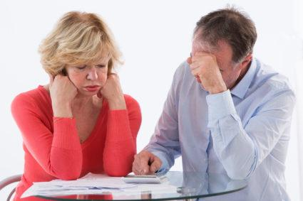 Senior couple  worried about paying bills and student loans.