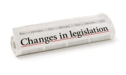 Rolled newspaper with the headline Changes in legislation.