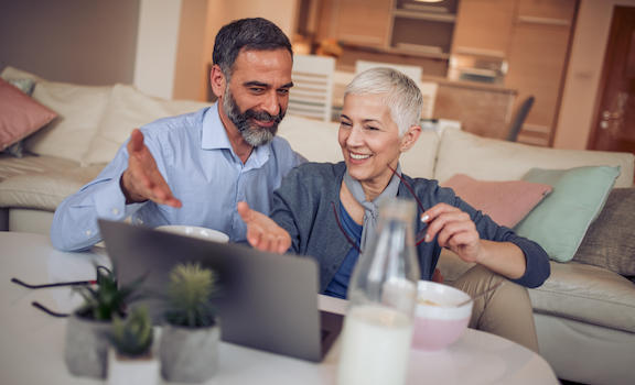 Mature couple looking at laptop - 529 Plans