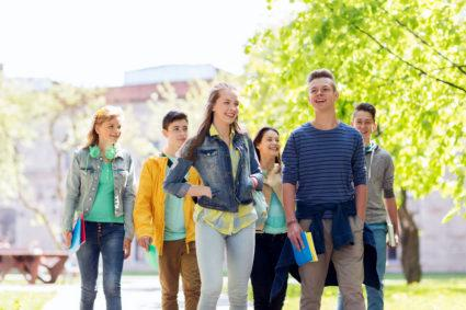 A group of high school juniors touring a college campus.