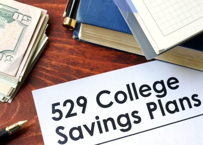 Image of 529 college savings plan paper with some money.