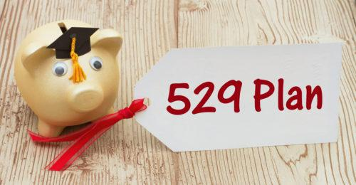 Your 529 education savings plan, A golden piggy bank and grad cap on a desk with a gift tag with text 529 Plan