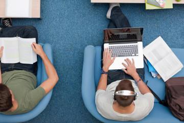 University student using laptop.