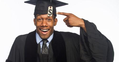 African American College Graduate Pointing to Money Sign