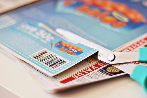 Scissors cutting coupons.