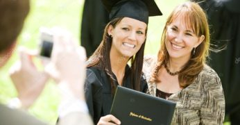 grad happy depositphotos_68262971-stock-photo-graduation-girl-poses-with-mom