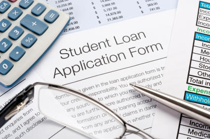Close up of Student Loan application Form with pen, calculator