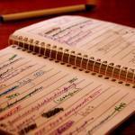 Handwritten list in a notebook.