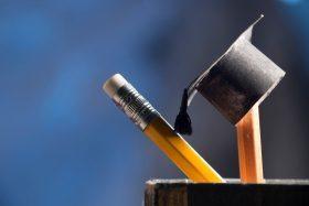 pencils and graduation hat, education concept