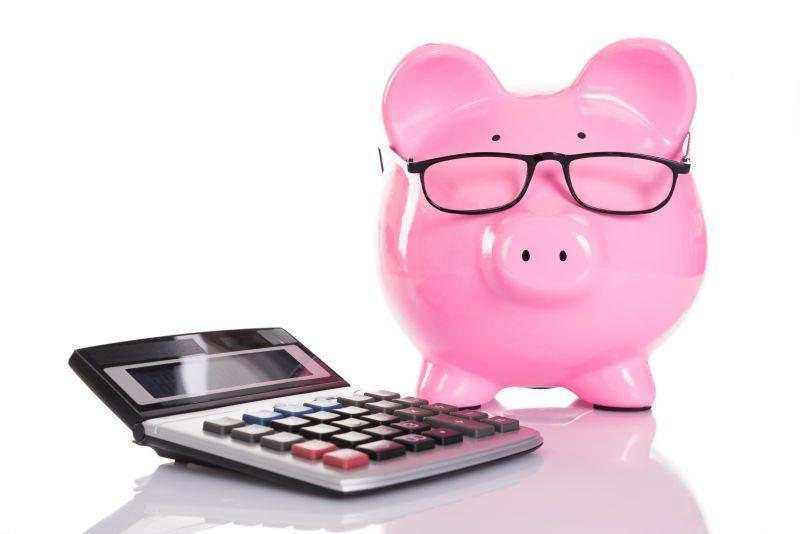 A piggy bank and a calculator.