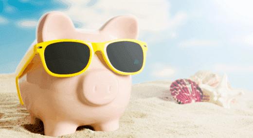 Piggy bank on beach - summer job budget