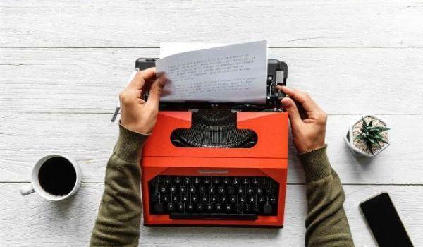 Many typing on a typewriter.