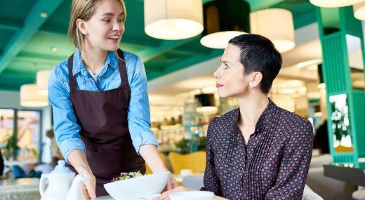 A student working as a waitress in a restaurant.